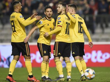 Perayaan gol dari kaki Eden Hazard pada laga perdana Kualifikasi Piala Eropa 2020 Grup I yang berlangsung di Stadion Roi Baudouin, Brussels, Jumat (22/3). Belgia menang 3-1 atas Rusia. (AFP/John Thys)