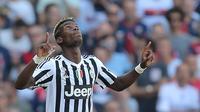 Gelandang Juventus, Paul Pogba, merayakan gol yang dicetaknya ke gawang Genoa pada laga Serie A di Stadion Luigi Ferraris, Genoa, Italia, Minggu (20/9/2015). Musim lalu, Pogba, sukses mengantar Juve juara Serie A. (AFP/Marco Bertorello)