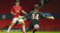 Pemain Manchester United, Daniel James, mencetak gol ke gawang Istanbul Basaksehir pada laga Liga Champions di Stadion Old Trafford, Rabu (25/11/2020). Setan Merah menang dengan skor 4-1. (AP/Dave Thompson)
