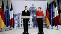 Emmanuel Macron dan Angela Merkel Perkuat Poros Paris - Jerman  (AFP)