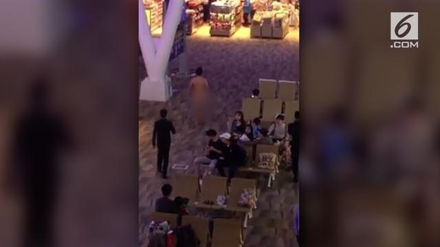 Pria asal New York bugil di bandara udara internasional Phuket, Thailand karena kelebihan dosis obat kuat