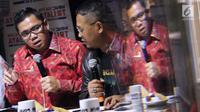 Anggota Komisi III DPR Fraksi PDI-Perjuangan, Arteria Dahlan (kiri) saat diskusi bertema KPK adalah Kunci yang digelar di Jakarta, Sabtu (7/9/2019). Diskusi membahas polemik revisi UU KPK dan dampaknya. (Liputan6.com/Helmi Fithriansyah)