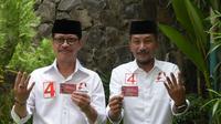 Paslon Ichsan Yasin Limpo-Andi Mudzakkar tebar Kartu Rakyat Sejahtera (KRS) untuk Emak-emak dan Petani di Sulsel (Liputan6.com/ Eka Hakim)