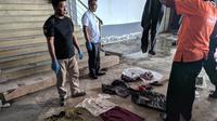 Polisi mengumpulkan berbagai barang bukti terkait peristiwa mutilasi di Malang (Liputan6.com/Zainul Arifin)