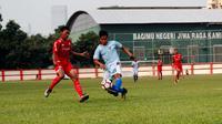 Persija U-16 menghadapi Persela U-16 dalam pertandingan pembukaan kompetisi Elite Pro Academy U-16 2018 yang digelar oleh PSSI. Pertandingan digelar di Stadion PTIK, Jakarta, Sabtu (15/9/2018). (Istimewa)