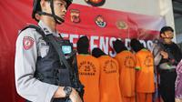 Polisi menangkap 7 pelaku pemerkosaan siswi SMA di Bogor (Liputan6.com/Achmad Sudarno)