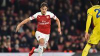 Aksi pemain baru Arseal, Denis Suarez pada leg 2, babak 16 besar Liga Europa yang berlangsung di stadion Emirates, London, Jumat (22/2). Arsenal menang 3-0 atas Bate Borisov. (AFP/Glyn Kirk)