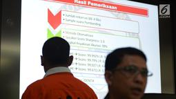 Direktorat Tindak Pidana Siber Bareskrim Polri menghadirkan tersangka BBP saat Rilis berita hoaks 7 kontainer surat suara tercoblos di Jakarta, Rabu (9/1). BBP diketahui sebagai pemilik suara rekaman hoaks yang viral tersebut. (Merdeka.com/Imam Buhori)