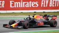 Pebalap Red Bull Max Verstappen melakukan selebrasi usai memenangkan F1 GP Jerman di Hockenheimring, Hockenheim, Minggu (28/7/2019). Ini adalah kemenangan kedua Verstappen pada persaingan F1 GP 2019. (Fabian Sommer/dpa via AP)