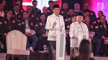 Ekspresi Jokowi - Ma'ruf Amin Saat Mengikuti Debat Perdana