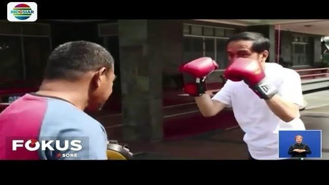 Presiden Jokowi berikan pesan kepada seluruh masyarakat lewat vlog-nya saat sedang latihan tinju.