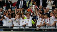 Manchester United meraih gelar juara Piala FA 2015-16 setelah mengalahkan Crystal Palace 2-1 di Stadion Wembley, Sabtu (21/5/2016). (AFP/Ian Kington)