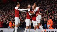 Perayaan gol pemain Arsenal yang dicetak Ramsey pada leg 1, babak perempat final Liga Europa yang berlangsung di Stadion Emirates, London, Jumat (12/4). Arsenal menang 2-0 atas Napoli. (AFP/Ben Stansall)