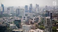 Suasana deretan gedung bertingkat dan rumah pemukiman warga terlihat dari gedung bertingkat di kawasan Jakarta, Jumat (29/9). Pemerintah meyakinkan target pertumbuhan ekonomi tahun 2018 sebesar 5,4 persen tetap realistis. (Liputan6.com/Faizal Fanani)