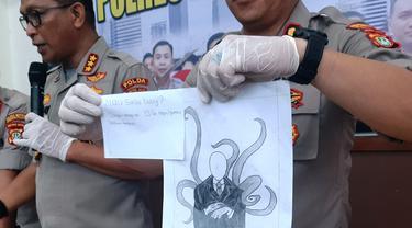 Polisi menunjukkan gambar NF (15), remaja yang bunuh bocah di Jakarta Pusat. (Liputan6.com/Yopi Makdori)