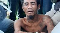 Foto: Andreas Pati Jumat, pelaku pembunuhan dua anak kandung di Adonara, Flores Timur, NTT (Liputan6.com/Ola Keda)