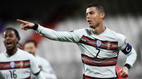 Cristiano Ronaldo. Striker Timnas Portugal ini telah mencetak 104 gol dari 175 caps untuk negaranya sebelum turnamen Euro 2020 berlangsung. Dirinya pun berpeluang memcahkan rekor striker Iran, Ali Daei sebagai pemegang rekor gol terbanyak Timnas dengan 109 gol. (Foto: AFP/John Thys)