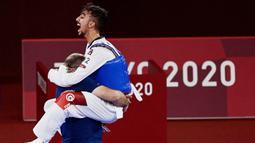 Atlet berusia 19 tahun itu berhasil meraih medali perak dalam cabang olahraga taekwondo pada Minggu (25/7/2021). (Foto/AFP/Javier Soriano)