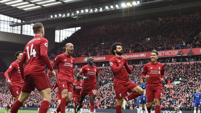 Penyerang Liverpool, Mohamed Salah, merayakan golnya ke gawang Chelsea dalam laga Liga Inggris di Stadion Anfield