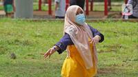 Aktivitas pagi hari pasien berstatus OTG (Orang Tanpa Gejala) di RSDC Wisma Atlet, Jakarta, Selasa (26/1/2021). Data Satgas Covid-19 per Selasa (26/1) mencatat kasus COVID-19 di Indonesia bertambah 13.094 sehingga total menyentuh angka satu juta, tepatnya 1.012.350. (Liputan6.com/Herman Zakharia)