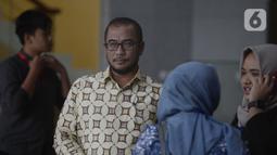Komisioner KPU Pusat, Hasyim Asy'ari tiba untuk dimintai keterangan oleh penyidik di Gedung KPK, Jakarta, Jumat (24/1/2020). Hasyim diperiksa sebagai saksi untuk tersangka mantan Komisioner KPU, Wahyu Setiawan. (merdeka.com/Dwi Narwoko)