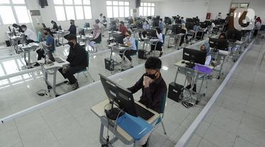 FOTO: Ujian Tulis Berbasis Komputer di Tengah Pandemi COVID-19