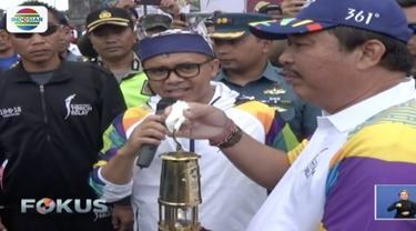 Suasana di Krobokan, Kabupaten Badung, Bali, mulai ramai oleh peserta yang siap menyambut kedatangan obor api Asian Games 2018.