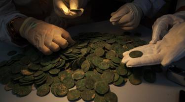 Ilustrasi koin kuno.