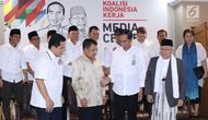 Calon Presiden petahana, Joko Widodo (kedua kanan depan) bersama Ketua Dewan Pengarah Tim Kampanye, Jusuf Kalla (kedua kiri depan) dan Ketua Tim Kampanye Nasional, Erick Thohir usai penetapan di Jakarta, Jumat (7/9). (Liputan6.com/Helmi Fithriansyah)