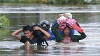 Ilustrasi banjir di Myanmar akibat hujan muson yang lebat (AFP/Ye Aung Thu)