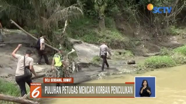 Petugas gabungan cari satu korban penculikan sekeluarga di Deli Serdang, Sumatra Utara.