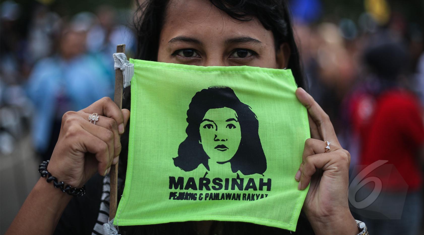 Para buruh yang tergabung dalam berbagai serikat menggelar aksi memperingati 22 tahun tanpa keadilan