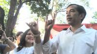 Jokowi dan Istri (Luqman Rimadi/Liputan6.com)