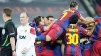 Para pemain Barcelona serentak bergembira usai mengalahkan Manchester United 3-1 pada partai final Liga Champions di Wembley Stadium, 28 Mei 2011. AFP PHOTO/FRANCK FIFE
