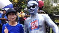 Ichsan menjadi satu-satunya caleg yang bekerja sebagai manusia milenium atau humanoid. (Liputan6.com/Achmad Sudarno)