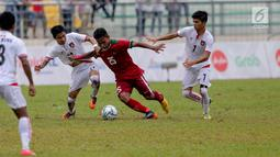 Aksi-aksi Osvaldo Ardiles Haay menyisir sisi kiri pertahanan Myanmar kerepotan, Osvaldo akhirnya mengirim satu operan manis kepada Septian Daivd yang berbuah gol pada Sea Games 2017. Indonesia menang 3-1. (Liputan6.com/Faizal Fanani)