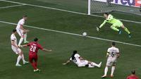 Baru 99 detik laga berjalan, Timnas Denmark mampu membobol gawang Timnas Belgia melalui Yussuf Poulsen. Gol tersebut merupakan yang tercepat di Euro 2020. (Foto: AP/Pool/Hannah McKay)