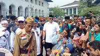 Presiden Jokowi mengenakan kostum ala pejuang di peringatan Hari Pahlawan Nasional di Bandung. (Liputan6.com/Huyogo Simbolon)