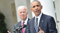 Presiden AS Barack Obama didampingi Wapres AS, Joe Biden memberikan pidato kemenangan capres dari Partai Republik, Donald Trump di Pilpres AS di Gedung Putih, Washington, DC (9/11).  (AFP PHOTO/Nicholas Kamm)