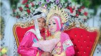 Sebuah foto resepsi pernikahan sesama jenis menjadi perbincangan warganet setelah diunggah oleh akun Facebook Ashock'photography pada Rabu, 27 September 2017. (Liputan6.com/Fauzan Sulaiman)