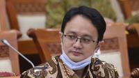 Wakil Mendag Jerry Sambuaga hadir pada rapat kerja di ruang rapat Komisi VI DPR RI, kompleks parlemen, Jakarta, Rabu (3/2/2021). Rapat juga membahas mengenai pelaksanaan investasi di masa pandemi Covid-19. (Liputan6.com/Angga Yuniar)
