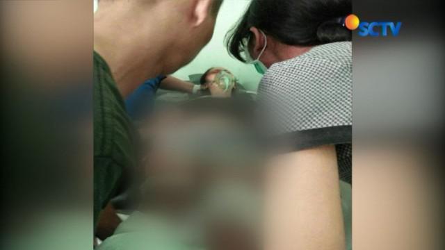 Ni Putu Kariani (33) kini terbaring lemah usai menjalani operasi pada bagian kakinya di Rumah Sakit Umum Pusat Sanglah, Denpasar, Bali.