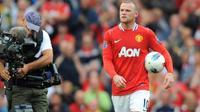 Striker Manchester United Wayne Rooney seusai mencetak hat-trick ke gawang Arsenal dalam lanjutan EPL di Old Trafford, 28 Agustus 2011. MU unggul 8-2. AFP PHOTO/ANDREW YATES
