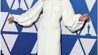 Lady Gaga dengan gaun putih kreasi Louis Vitton. (dok.Instagram @popsugar/https://www.instagram.com/p/BtgsA0pgwIp/Henry