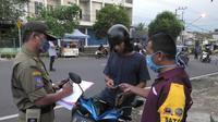 Cek poin pemeriksaan pengguna jalan di Purwokerto, termasuk kewajiban penggunaan masker. (Foto: Liputan6.com/Humas Pemkab Banyumas)