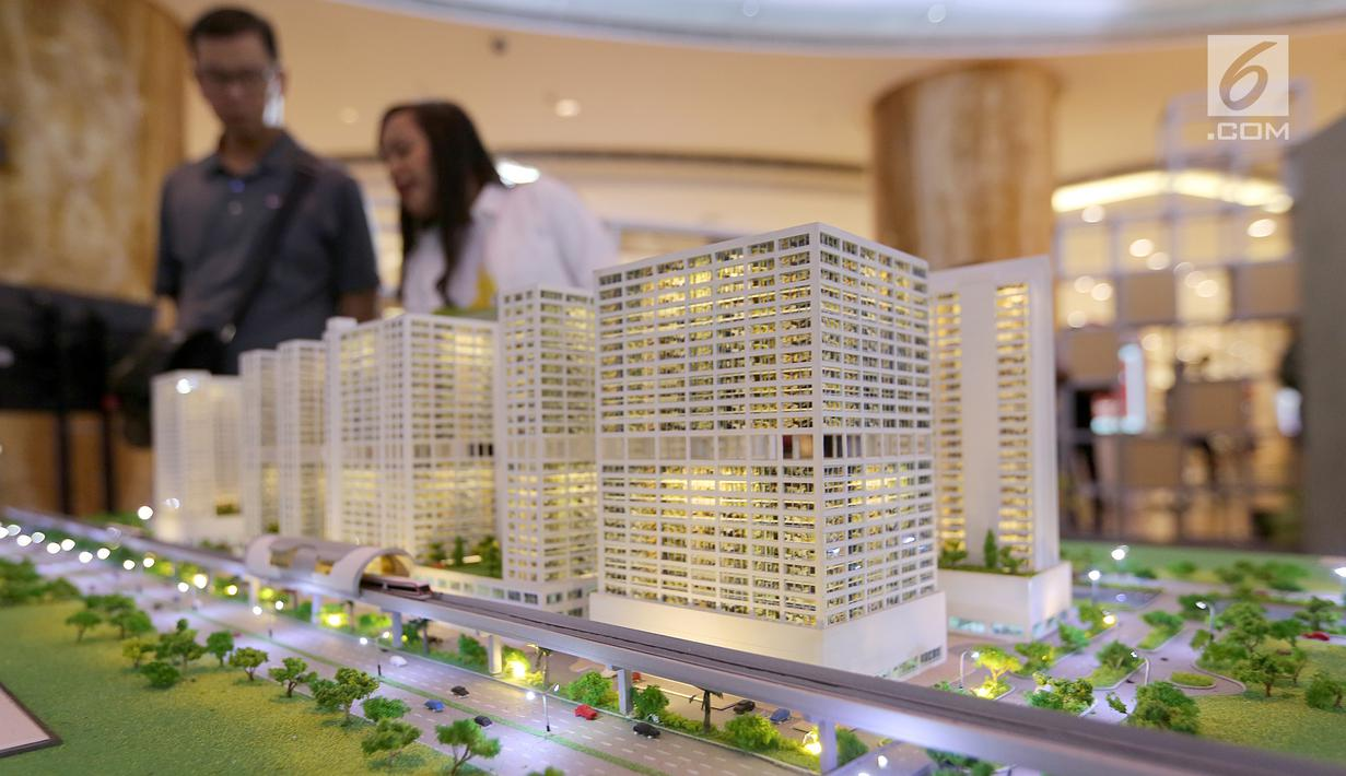 Sebuah maket plan LRT City yang mengusung konsep Transit Oriented Development (TOD) digelar pada pameran properti LRT City Expo di Jakarta, Sabtu (21/7). Pameran konsep urban lifestyle menghadirkan tujuh proyek LRT City. (Liputan6.com)