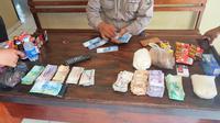 Marak uang palsu jelang pilkada di Konawe (Liputan6.com / Ahmad Akbar Fua)
