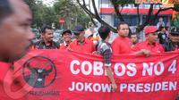 Kedatangan Jokowi disambut antusiasme masyarakat yang sudah menunggu sejak siang (Liputan6.com/Herman Zakharia)