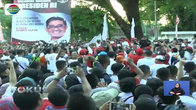Semarakkan Asian Games 2018, warga Makassar ikuti jalan sehat bersama Presiden Jokowi.