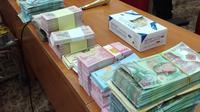 Pengungkapan kasus uang palsu. (Liputan6.com/ Ady Anugrahadi)